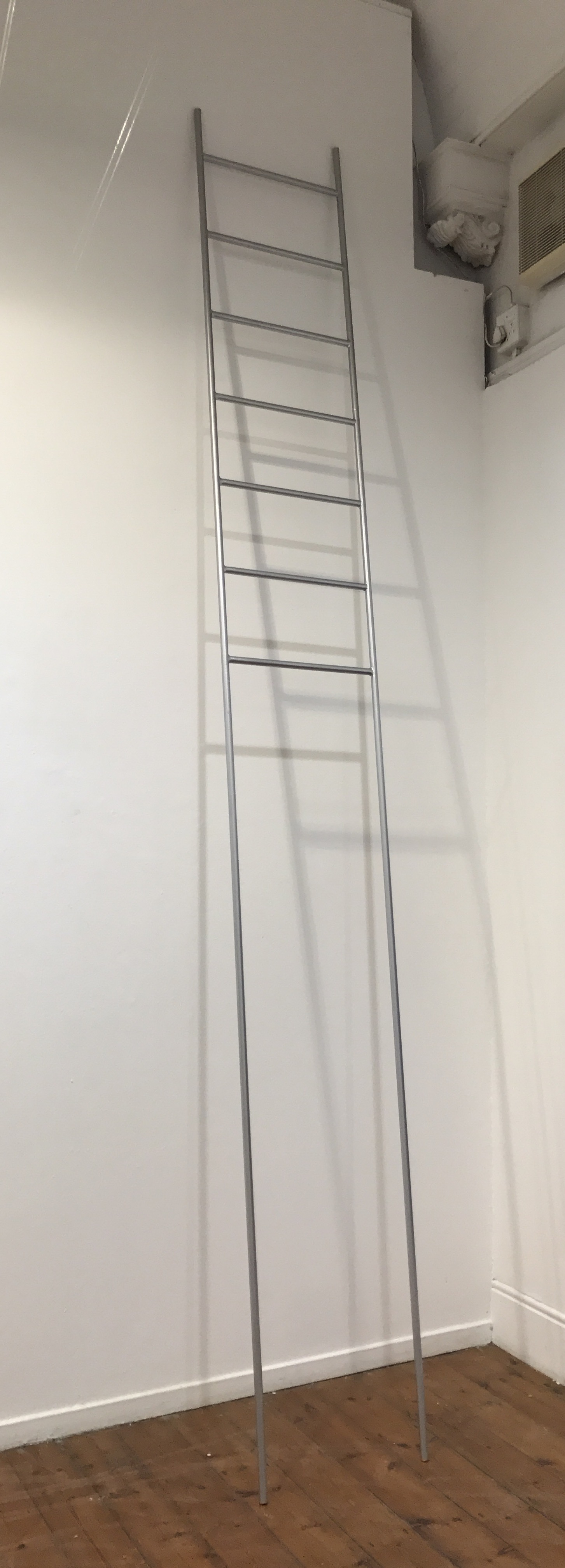 an art piece made of a galvanized steel ladder