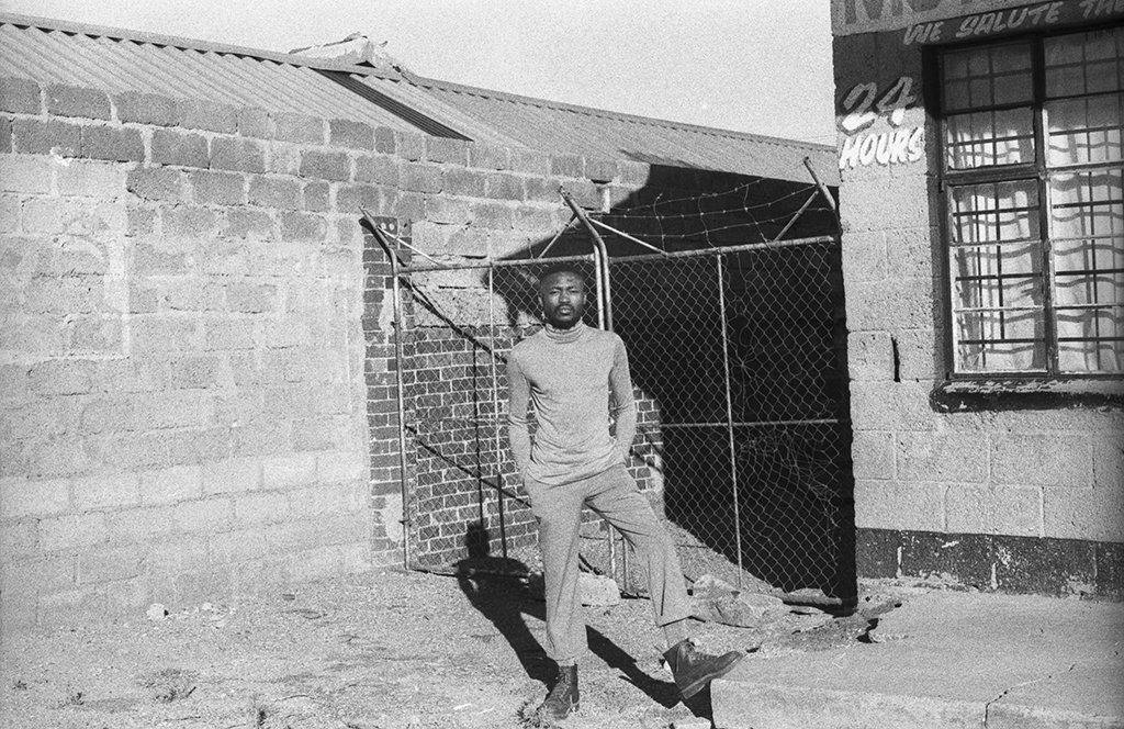 Sipho Gongxeka posing in a old-style photo in Soweto