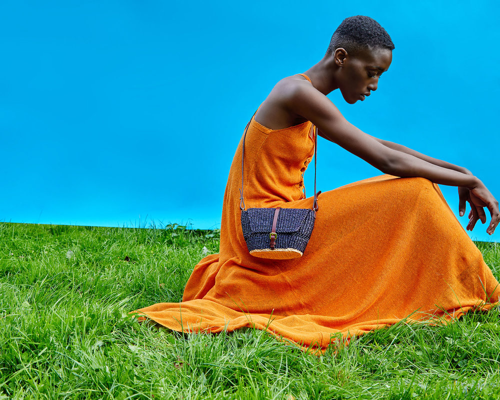 BIka Noir handbag by AAKS being worn by a model in front of a blue background