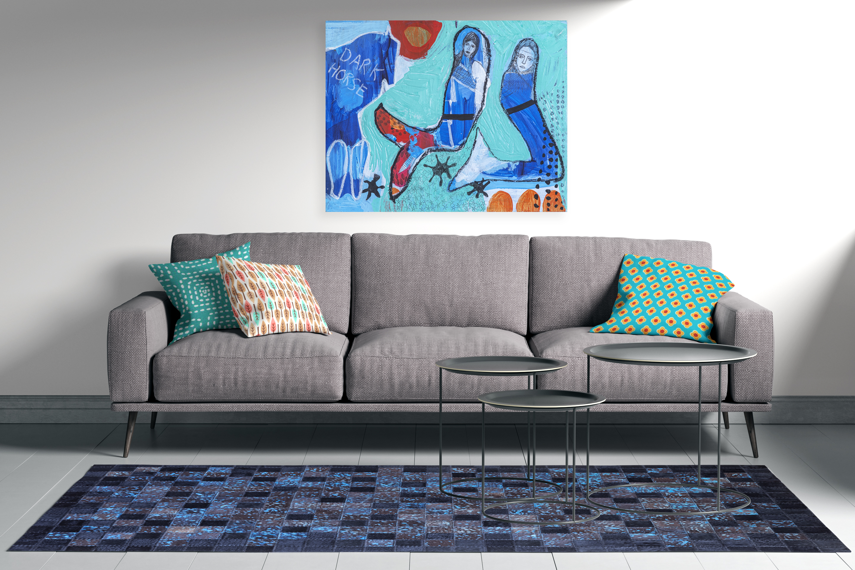 Blue designer hide in front of a grey couch
