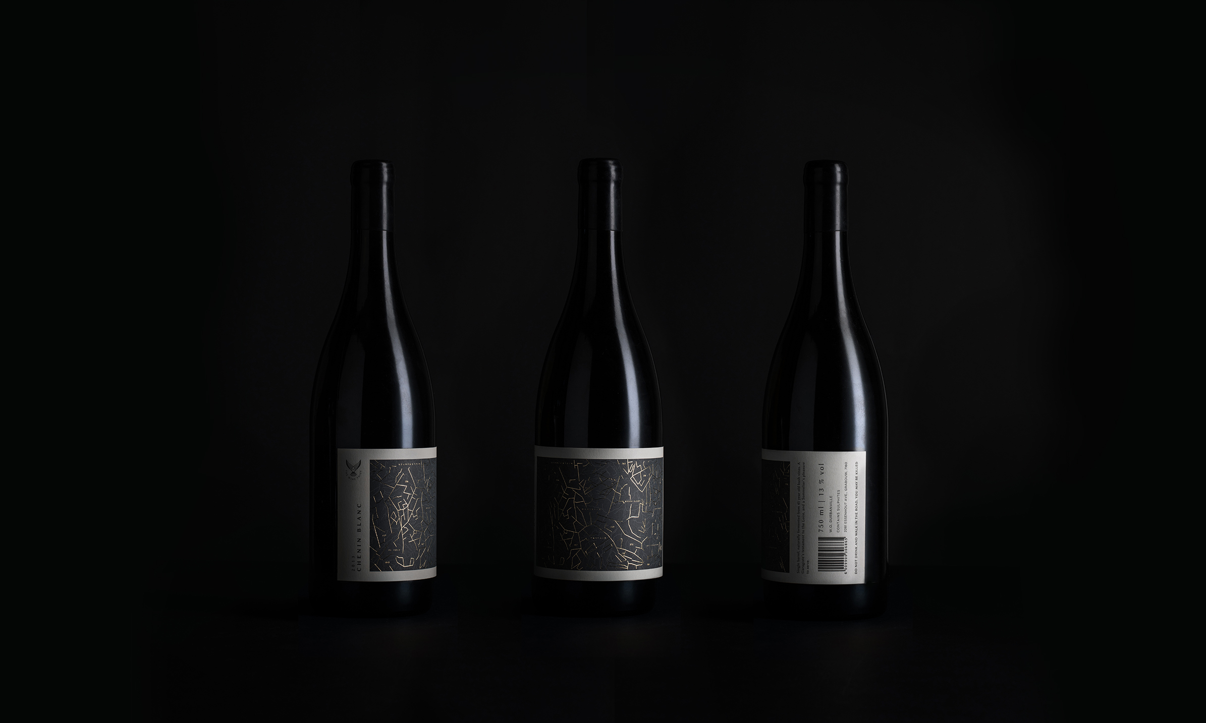 Grey labels on wine bottles from Studio Collective