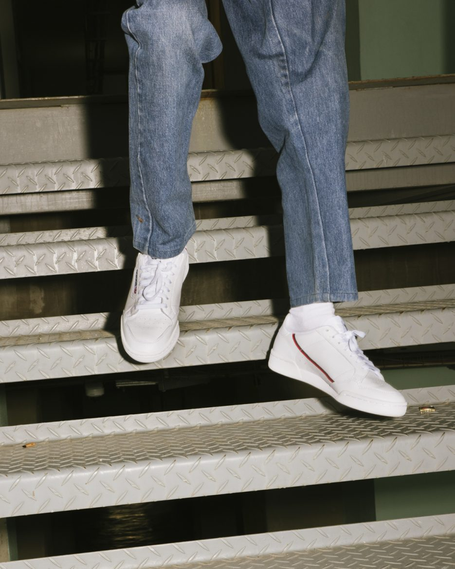 Adidas Continental 80 Sneakers being worn with jeans.