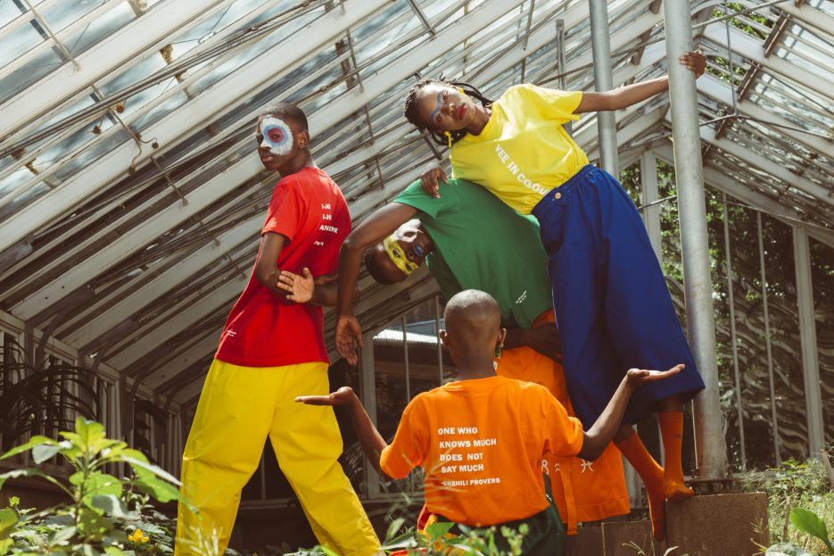 A group of people posing wearing bright clothing from Vee in Colour.