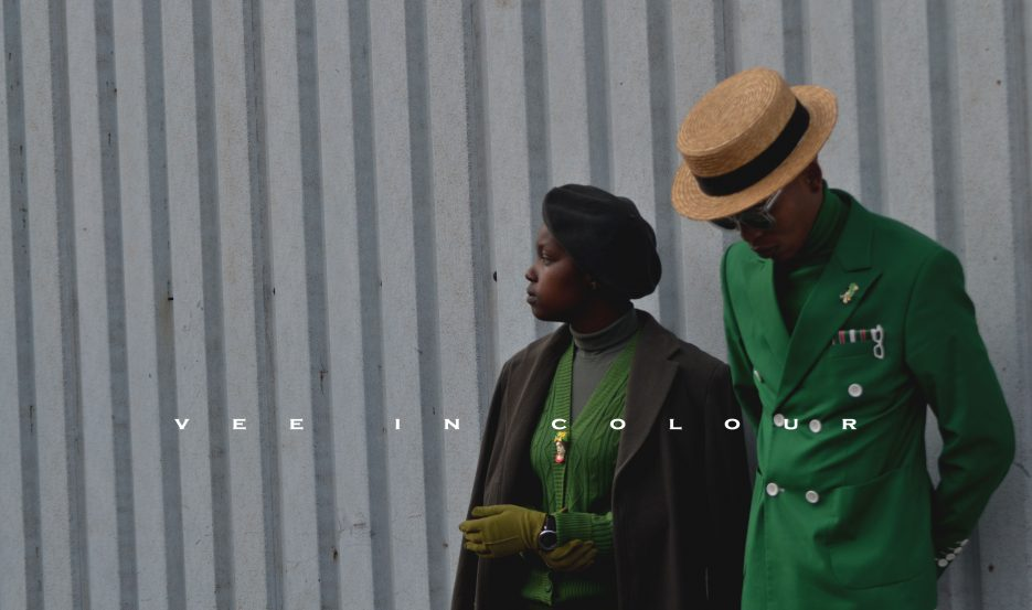 A man and lady wearing green pieces from Vee in Colour