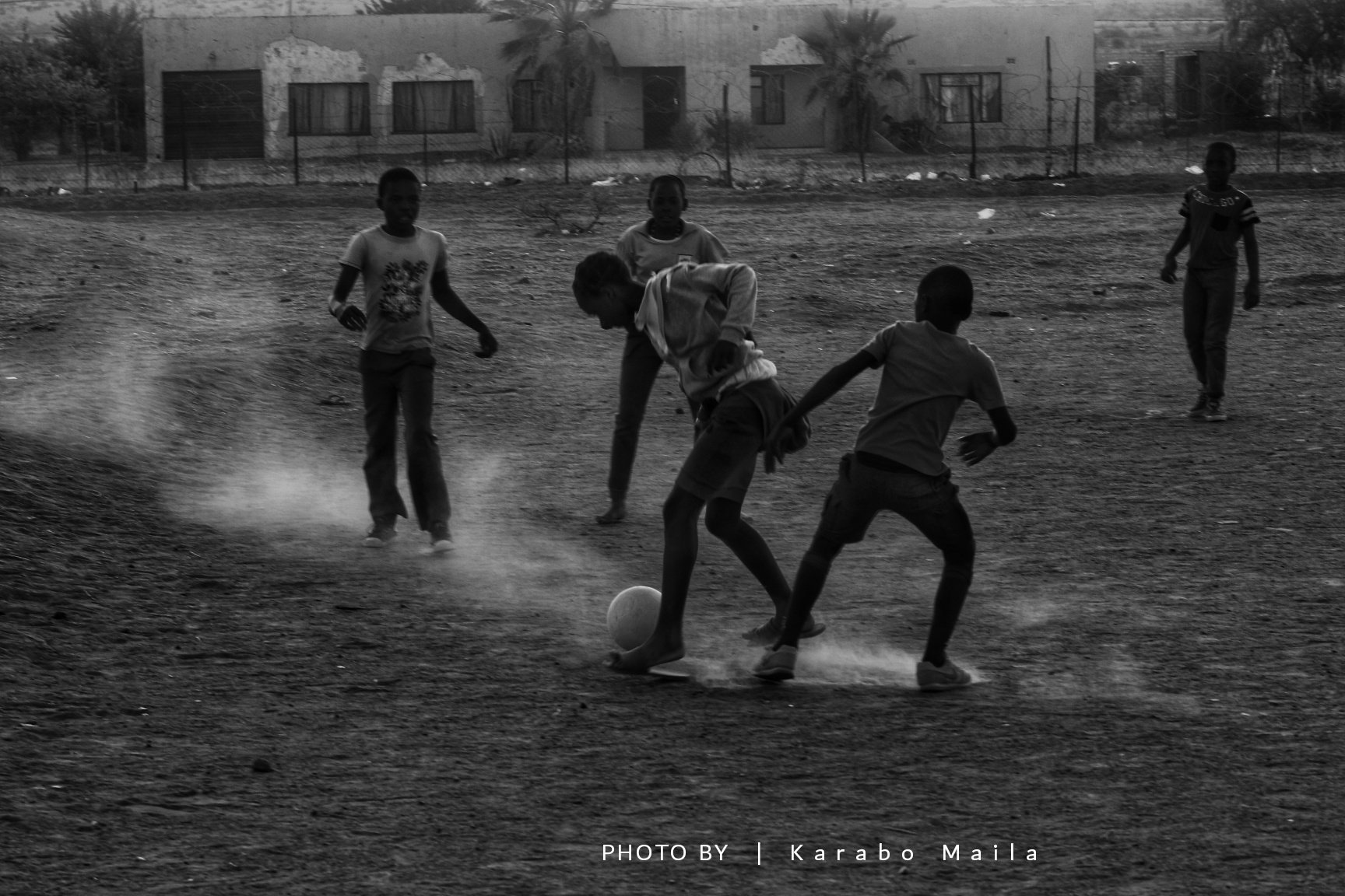 Children playing soccer in a township taken by Karabo Maila