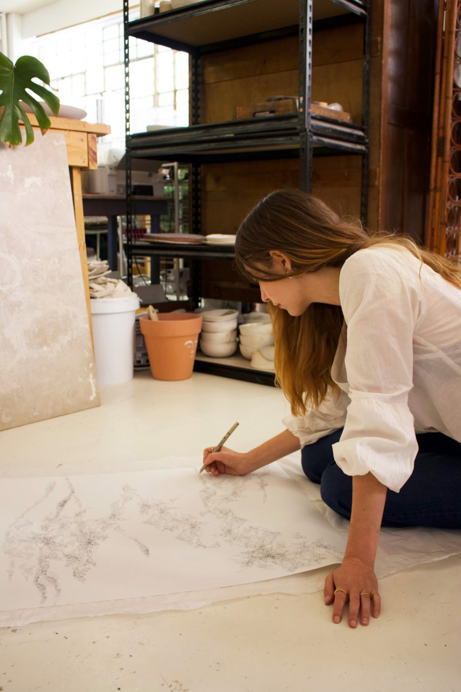 Amor Coetzee of Dayfeels illustrating in her Cape Town studio. Image by Amber Rose Cowie.