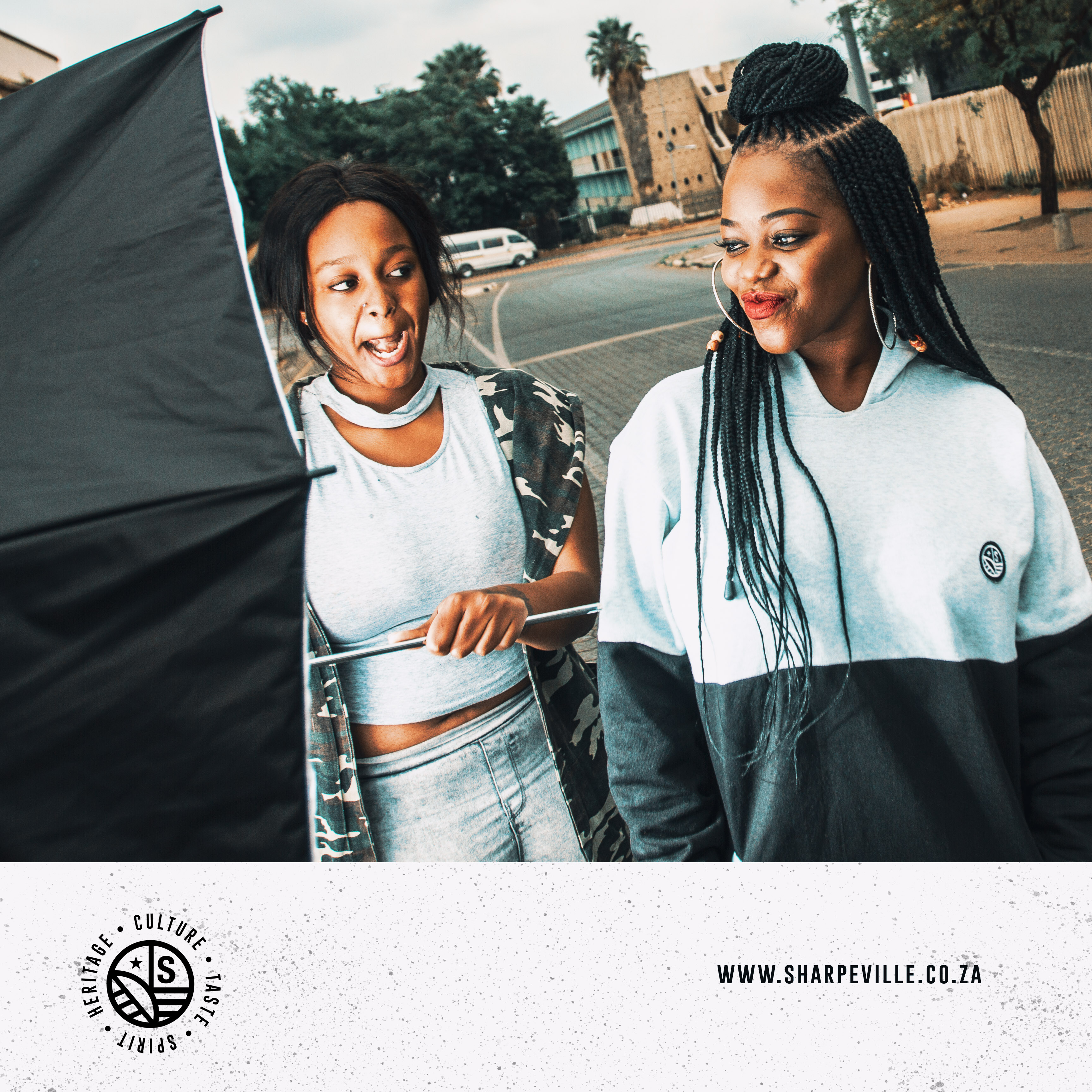 A sharpeville website banner with two ladies walking in the street in Sharpeville
