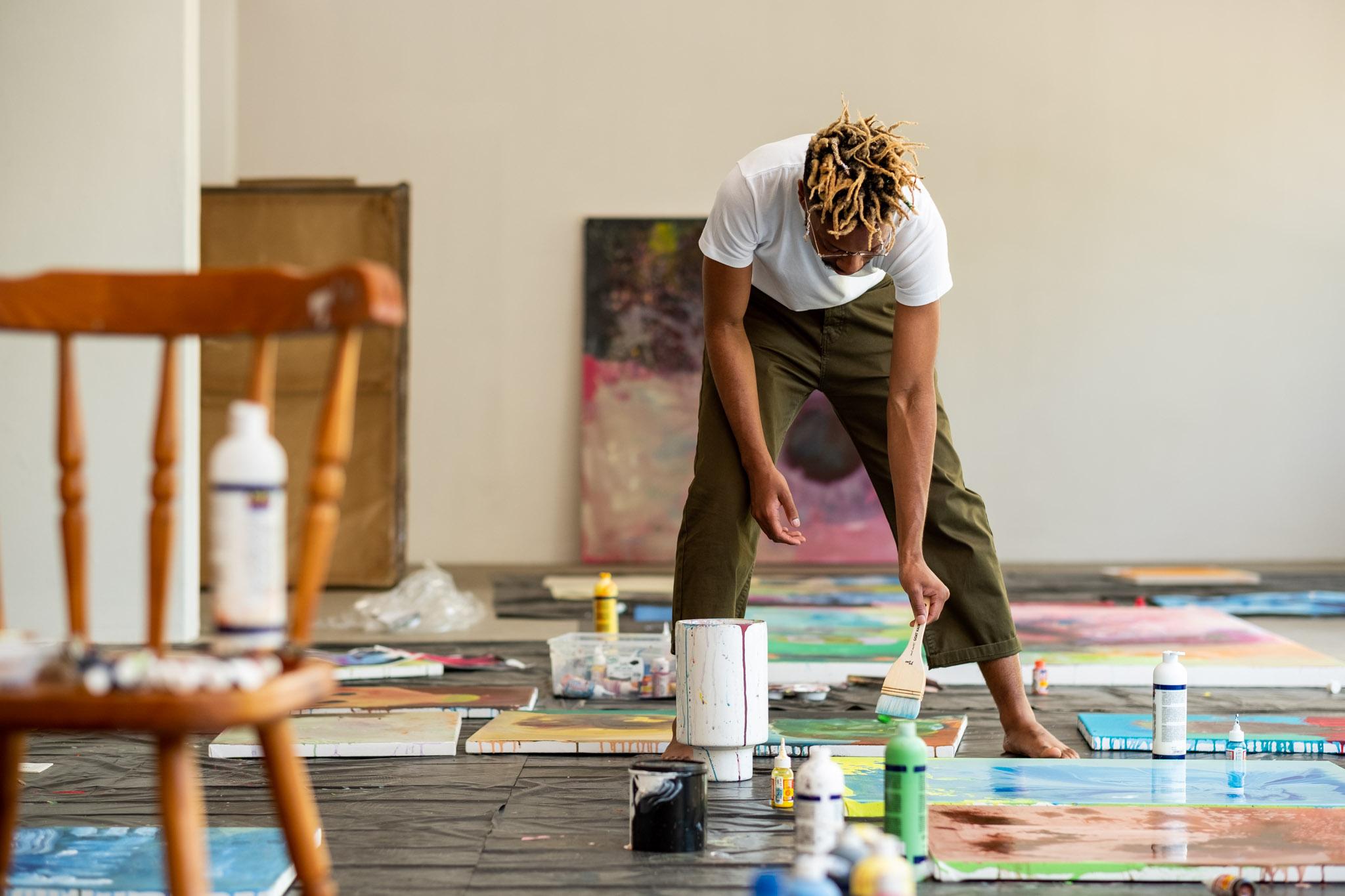 Banele Khoza working on his artwork taken by Bernard Brand