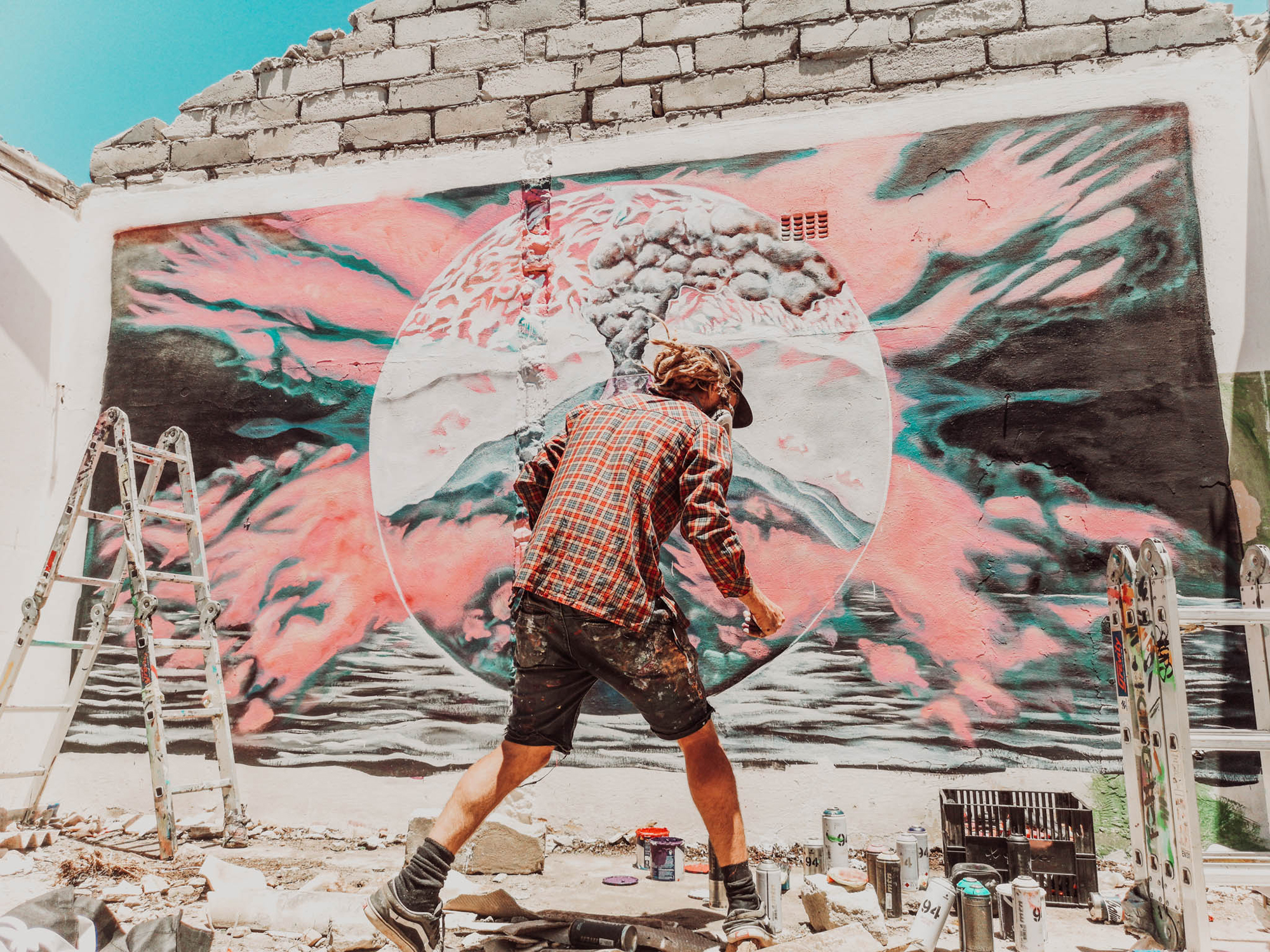 Marti Lund Spray Painting a Wall